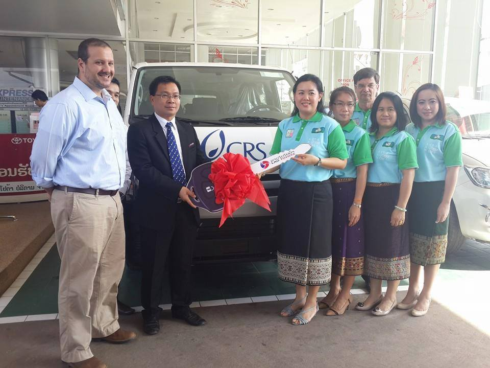 CRS Country Representative Bernie Chaves and LTS Sales Manager Thongsamouth Luanglath handing over the key to AfA President Viengsam Indavong