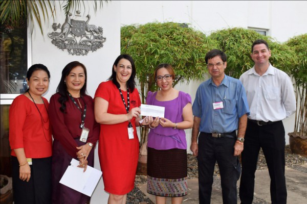Representatives of the Direct Aid Program (DAP) at the Australian Embassy in Vientiane hand over the cheque for the grant to AfA Secretary-General, Misouda Heuangsoukkoun.   Photo credit: DFAT / Mingngakham Pangnasak.